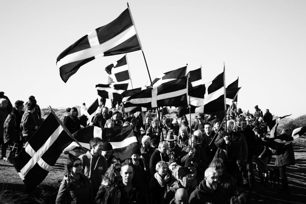 St Piran's Day Parade and sea of St Piran's flags being waved on March the 5